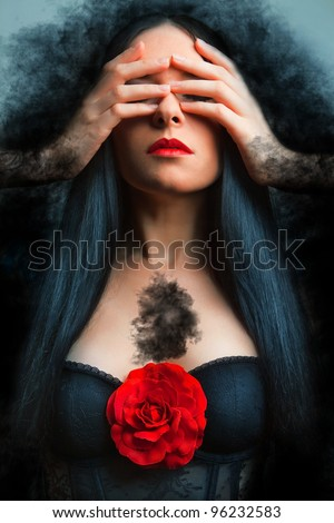 Vogue style photo of a gothic woman with red rose. - stock photo