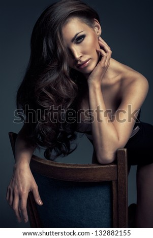 Vogue style photo of very delicate brunette woman - stock photo