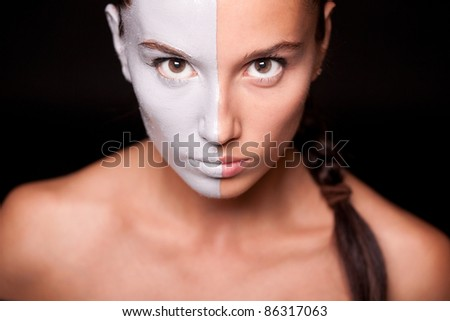Vogue style portrait of a woman with white makeup. Closeup. - stock photo