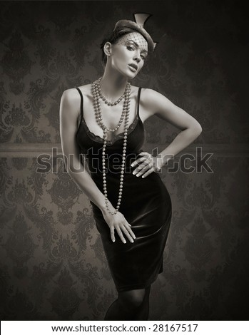 Vogue style vintage portrait in the dim light - stock photo