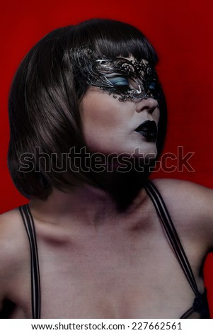 vogue woman with venetian mask, red background - stock photo