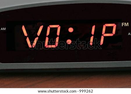 Voice Over IP (VOIP) on alarm clock - stock photo