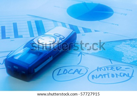 Voice recorder on documents with world map, graphs and mind map - stock photo