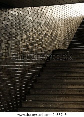 Void passage with dirty stairway - stock photo