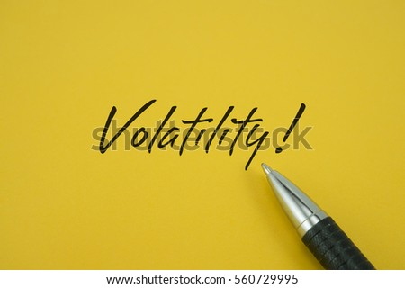 Volatility! note with pen on yellow background