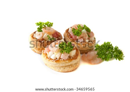 Volauvens filled with fresh shrimp salad isolated on white - stock photo