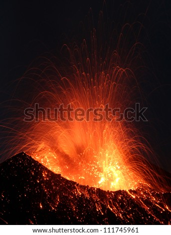 Volcanic Eruption. Active volcano Stromboli in Italy erupting  day and night every 20 minutes emitting dust, sand, ash and lava and lots of  toxic gasses - stock photo