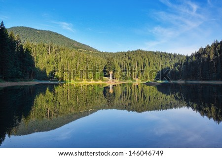 Volcanic lake in the Carpathian Mountains, the village Sinevir. Ukraine. - stock photo