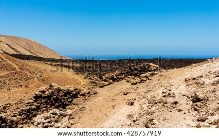 Volcanic landscape in a sunny day, Lanzarote, Spain  - stock photo
