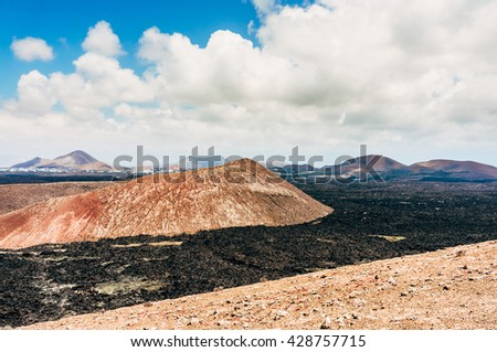 Volcanic Landscape in the Timanfaya national park in Lanzarote, Canary Islands - stock photo