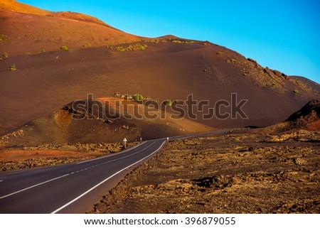 Volcanic landscape in Tmanfaya national park on Lanzarote island in Spain - stock photo