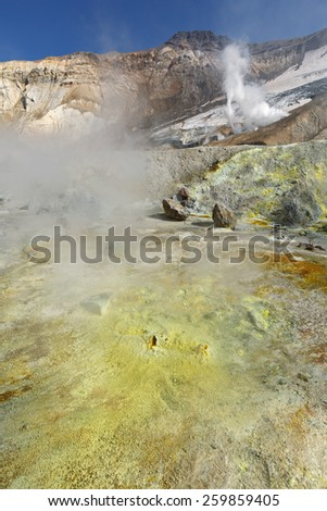 Volcanic landscape of Kamchatka: brimstone and fumarole field in crater of active Mutnovsky Volcano. Russia, Far East - stock photo