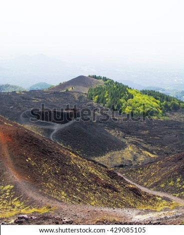 Volcanic landscape of Mount Etna with crater, Sicily, Italy - stock photo