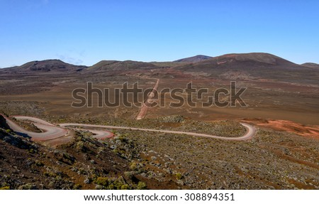 Volcanic landscape of Plaine des Sables and dirt road, Reunion Island