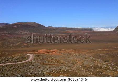 Volcanic landscape of Plaine des Sables with a road, Reunion Island - stock photo