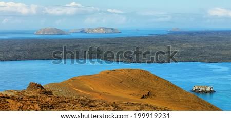Volcanic landscape of Santiago island from Bartolome, Galapagos, Ecuador - stock photo