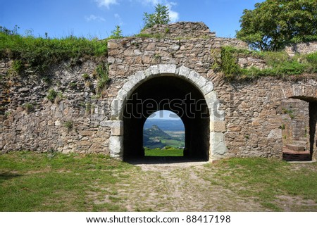 Volcanic landscape viewed through a stone gate of a mediaeval castle at the Hohentwiel, Singen, Germany (HDR version) - stock photo