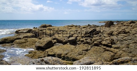 Volcanic lava rocks at the shore of Lanzarote island, Spain - stock photo
