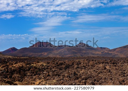 Volcanic  Mountains in Lanzarote island, Spain - stock photo