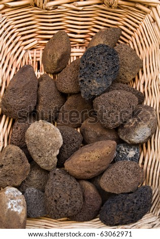Volcanic pumice for sale in a wicker basket. - stock photo