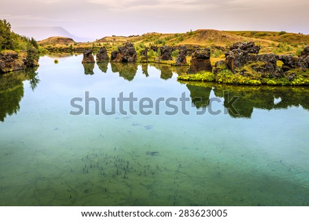 Volcanic rock formations in Lake Myvatn in Northern Iceland - stock photo