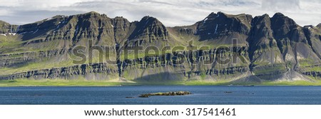 Volcanic rocks and hills near the sea in Iceland
