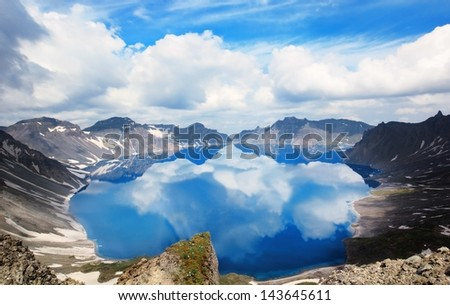 Volcanic rocky mountains and lake Tianchi, wild landscape, national park Changbaishan, China - stock photo