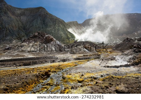 Volcanic Wasteland - inside the crater, colorful ground, white smoke - Whakarri or White Island in the Bay of Plenty, New Zealand. - stock photo