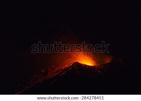 Volcano activity on night - 2015 Etna eruption, motion blur - stock photo