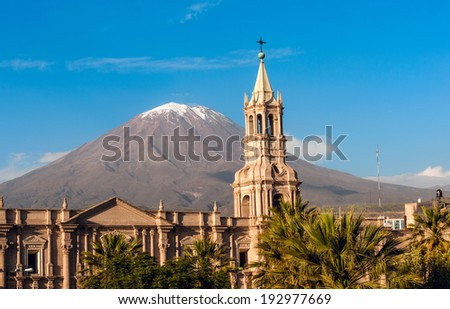 Volcano El Misti overlooks the city Arequipa in southern Peru. Arequipa is the second most populous city of the country. Arequipa lies in the Andes mountains - stock photo