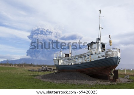 Volcano Eruption in Iceland Ash, Sky and boat - stock photo