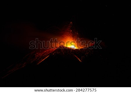 Volcano eruption on night, motion blur - stock photo