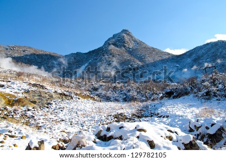 volcano hot springs in Japanese mountains in winter, Hakone Japan - stock photo