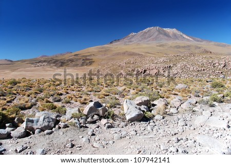 volcano in the dry bolivian chilean desert - stock photo