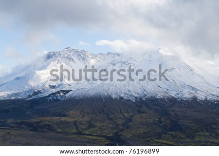 volcano mount Saint Helens decapitated top with glacier in clouds - stock photo