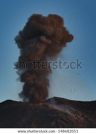 volcano Stromboli. ash  eruption  at the blue hour - stock photo