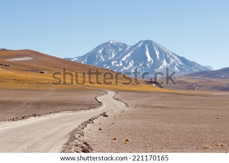 Volcanoes at Lagunas Miscanti and Meniques in Atacama desert - stock photo