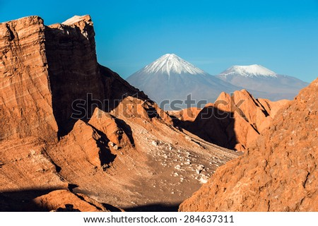 Volcanoes Licancabur and Juriques, Cordillera de la Sal, Atacama desert, Chile - stock photo