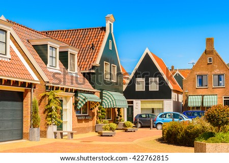 VOLENDAM, NETHERLANDS - MAY 2, 2015: Houses in Volendam, Netherlands. Volendam is a popular touristic destination in North Holland