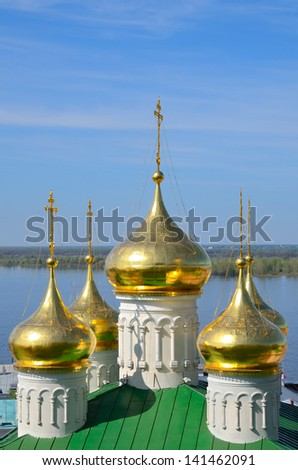Volga river and golden domes of the Church of St John the Baptist in Nizhny Novgorod, Russia. Church was built in the 15th century. - stock photo