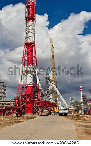 VOLGOGRAD - APRIL 28: Unloading sections of the boom of a large crawler crane using a crane on site of a petrochemical plant . April 28, 2016 in Volgograd, Russia.