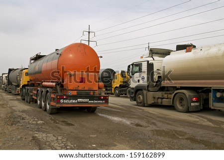 VOLGOGRAD - OCTOBER 19: Tank trucks are waiting to fill bitumen near the refinery. October 19, 2013 in Volgograd, Russia.