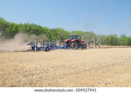 "Volgograd, Russia - JULY 31, 2014: Demonstration of agricultural machinery in ""Fild Days"" -annual review of agricultural machinery, which took place on July 31 - August 1, 2014, Volgograd, Russia"