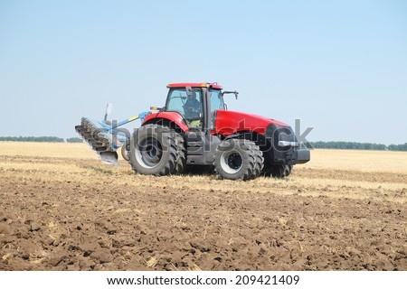 "Volgograd, Russia - JULY 31, 2014: Demonstration of agricultural machinery in the context of ""Field Days"" -annual review of agricultural machinery, which took place on July 31, 2014, Volgograd, Russia"