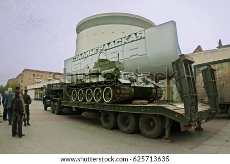 "Volgograd, Russia - May 07, 2011: The T-34 tank is loaded onto the auto platform on the background of the panorama museum ""Battle of Stalingrad"" for transportation to the parade site in Volgograd"