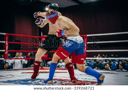 Volgograd, Russia - October 24, 2015: athlete mixed martial arts hits his hand on head of opponent during Championship of Russia on mixed martial arts - stock photo