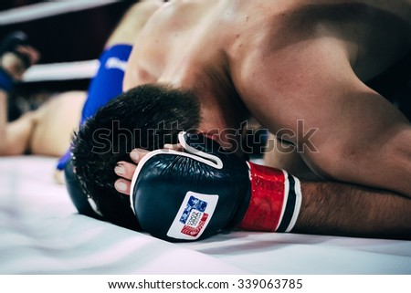 Volgograd, Russia - October 24, 2015: closeup of head and gloved hands MMA fighter during Championship of Russia on mixed martial arts - stock photo