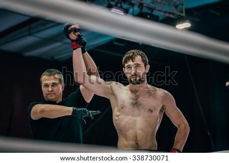 Volgograd, Russia - October 24, 2015: fighter mixed martial arts blow to head opponent lying on floor during Championship of Russia on mixed martial arts - stock photo