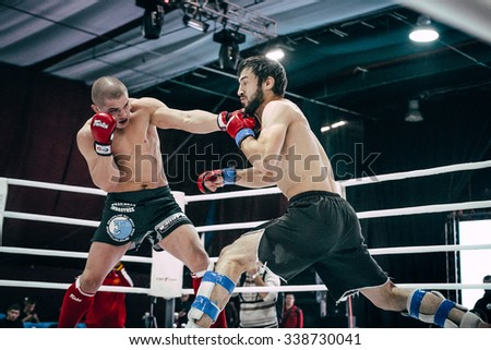 Volgograd, Russia - October 24, 2015: MMA fighter straight punch head by his opponent during Championship of Russia on mixed martial arts - stock photo