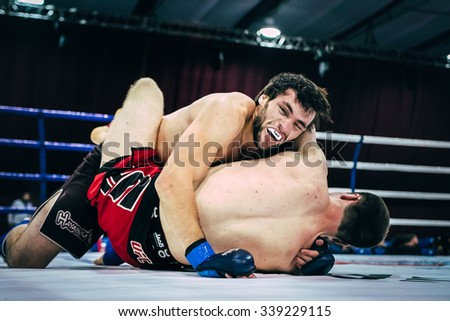 Volgograd, Russia - October 24, 2015: two athletes MMA ground fighting during Championship of Russia on mixed martial arts - stock photo